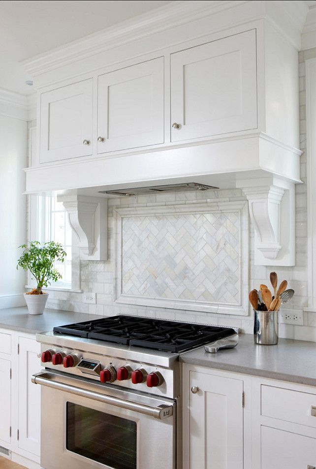 """Kitchen Backsplah Ideas. Looking for backsplash ideas? You have found a classic one! The backsplash in this kitchen is a Carrara Bianco Herringbone """"picture frame"""" edged with a chair rail. The grout color for this kitchen is called """"Silverado"""" by Tec.. #Kitchen #Backsplash"""