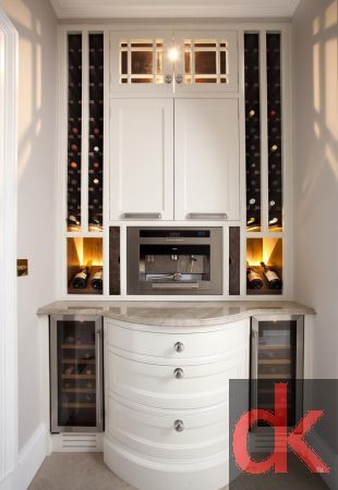 Luxury Kitchen Wine Rack with lighting.  Painted kitchen doors with wine coolers