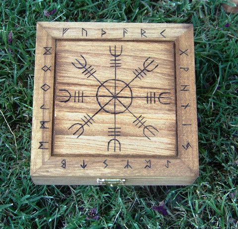 """This hand-burned Norse Protection Box is great for storing runes and other trinkets of the faith.  The centerpiece is the Helm of Awe and is a known symbol of protection and is framed by the Elder Futhark Runic alphabet.  A great gift for those of the Asatru faith or anyone following the Norse pantheon.  Stained and sealed for protection, it measures 5 3/4"""" x 5 3/4"""" x 2"""". Also would make a GREAT TRAVEL ALTAR"""