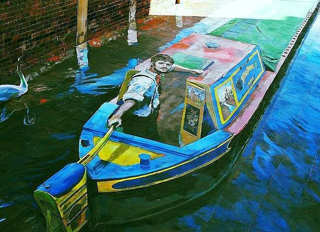 3D illusion pavement art done by Stoke-on-Trent artist Rob Pointon, showing a narrow boat travelling along what was once the Newcastle-under-Lyme canal. Trompe-l'œil. #StreetArt