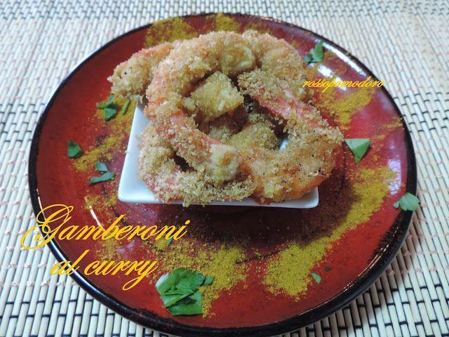 Gamberoni al curry gratinati al forno