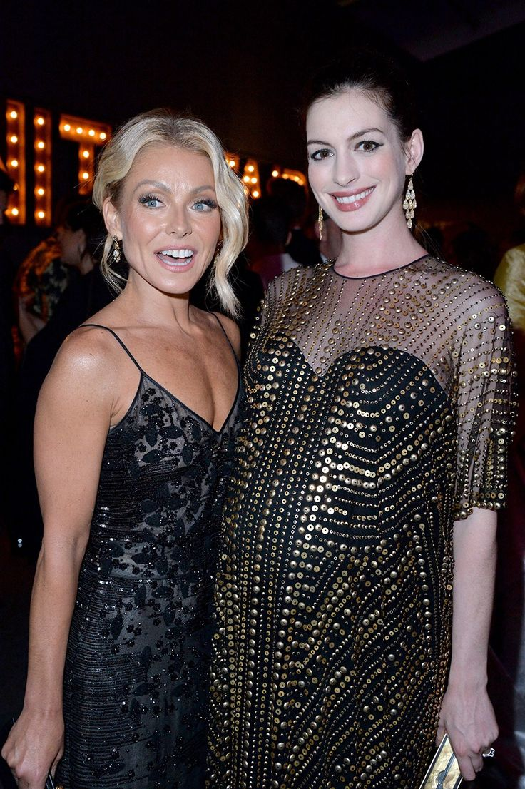 Kelly Ripa and Anne Hathaway inside the #VFOscarParty.