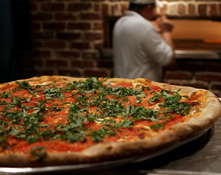 An uptown pizza and wine bar