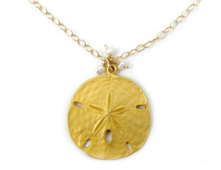 "Sand Dollar Pendant Pendant Necklace, 14K Gold Fill, Adjustable to 19-Inches. Beloved by many, the sand dollar is often the symbol of a favorite beach, a special memory, or spiritual inspiration. 14k gold-filled sand dollar pendant. Accompanied by three demure cultured white pearls and a link chain, also of 14k gold-fill. Adjustable up to 19"". Made in the USA."