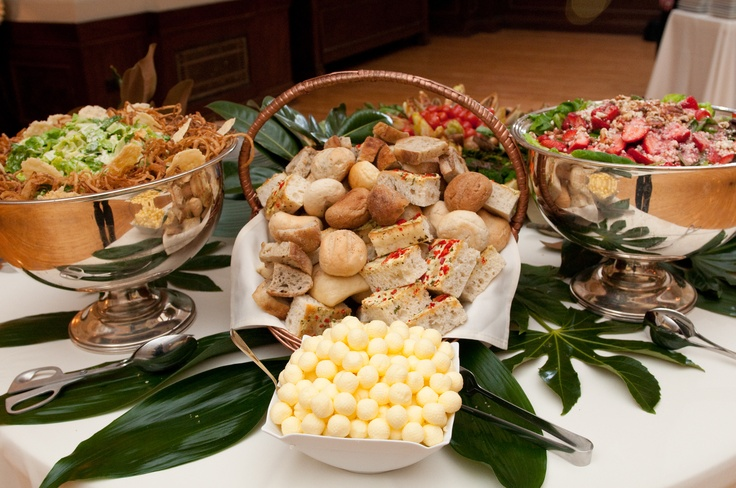 (Left to right) Caesar Salad, Assorted Breads with Butter Balls and Kentucky Bibb and Berry Salad.