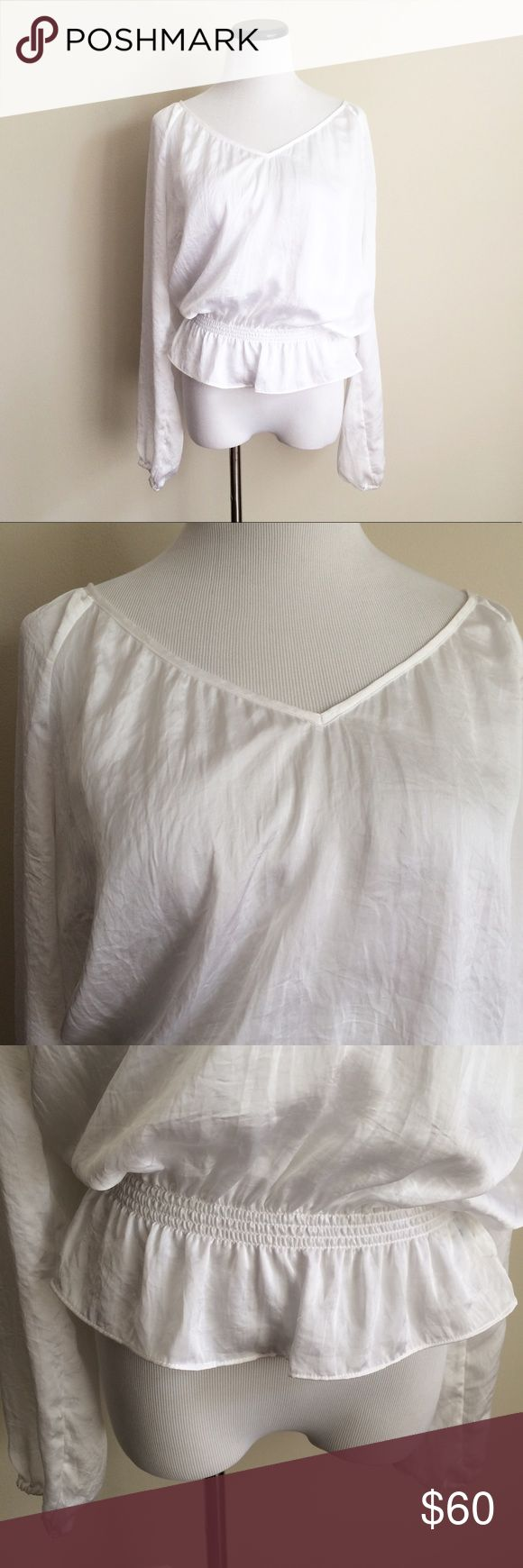 "MICHAEL KORS White ruffle long sleeve Peplum Top Gently worn and has been dry cleaned. White 100% polyester peplum top. Slight v-neck. Length 23"". Chest 21.5"". MICHAEL Michael Kors Tops Blouses"