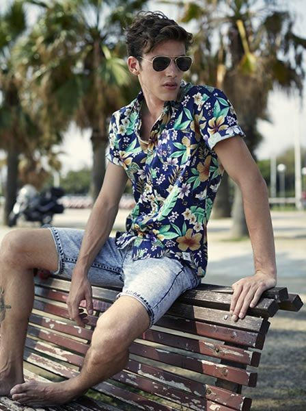 The floral shirt reminds me of summer afternoons at the beach.