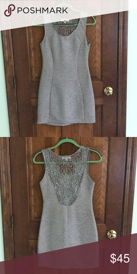 Silver Bodycon Dress Silver bodycon dress with lace/ sparkle back. Mint condition. Ya Los Angeles Dresses Mini