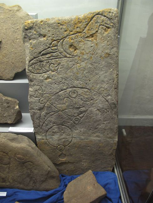 Pictish symbol stone with eagle crescent rod and mirror