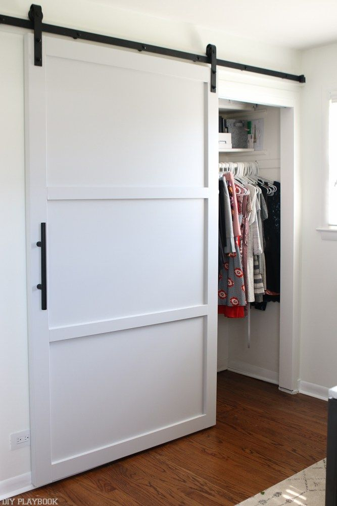 Loving this gray and modern barn door. Choosing the perfect shade of gray was difficult, but it turned out perfectly. Come learn how to build your own DIY barn door with a twist. So much better than old bypass doors.