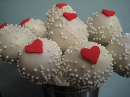 These cupcake pops would fit right in at a whimsical wedding, and everything tastes better when it's on a stick (see: corndogs, popsicles, satay, pickles, pizza).      More favor ideas: http://www.smartbrideboutique.com/blog/bride-to-be-flavor-favors/20120126/548/