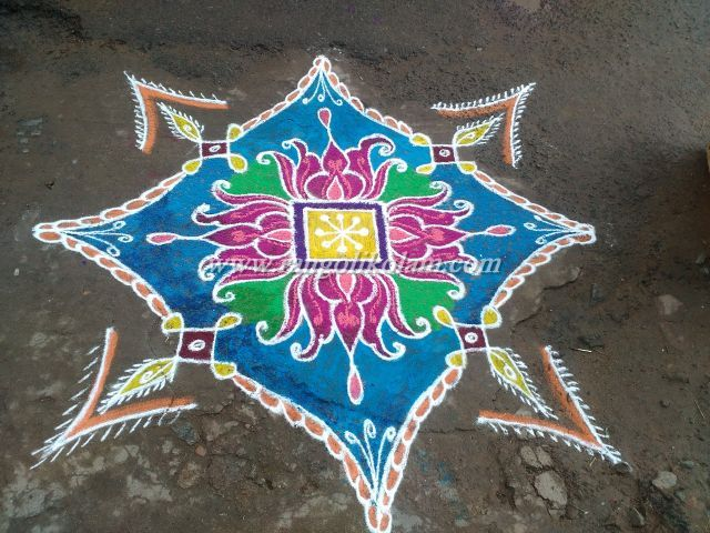 Lotus kolam with colourful design... Draw the simple design at the center. Add the four lotuses coloured blue on four sides and filled the lotus with pink colour & designed with fussion deep...
