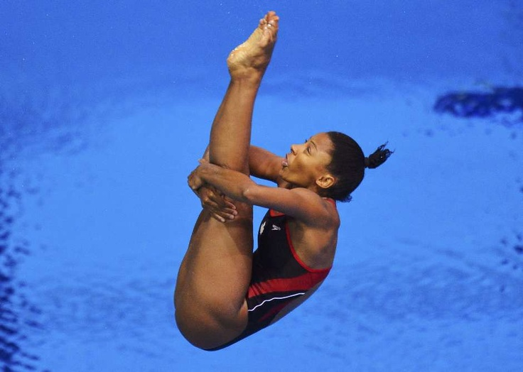 Canada's Jennifer Abel performs a dive during the women's 3m springboard diving event at the London 2012 Olympic Games at the Aquatics Centre