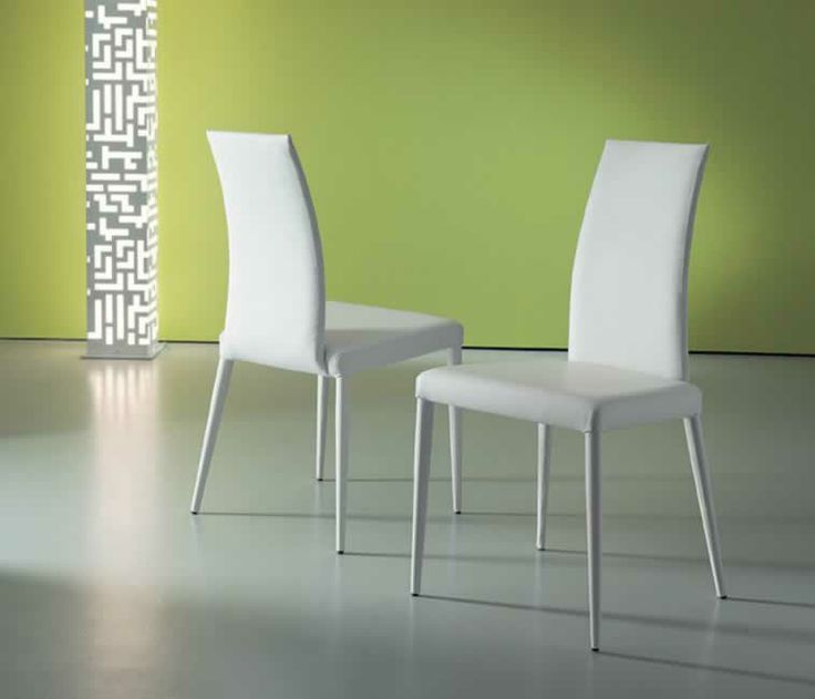 OCEANIA, design: Giuliano Cappelletti architetto - Metal frame chair with soft leather covering.www.ozzio.com