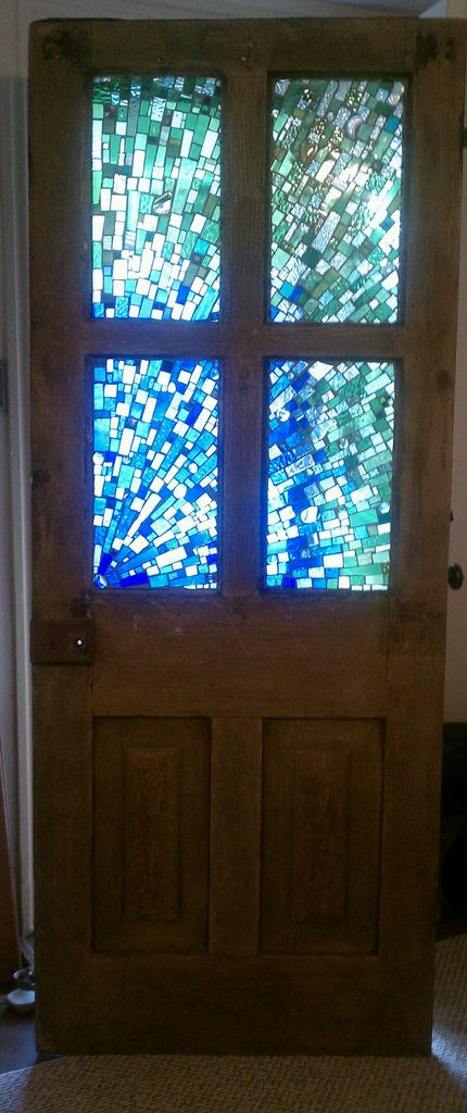 Mosaic door - would look awesome in  reds, oranges, and yellows and in a window!