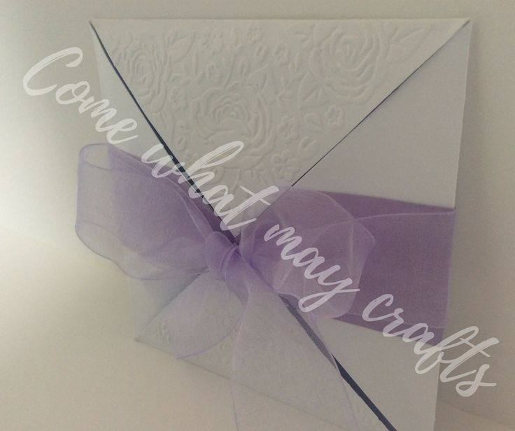 Beautifully elegant four way opening wedding invitation, with personalised colour to suit your wedding scheme. Then finished with beautiful English rose embossing on two of the four flaps. Completely handmade by Come What May Crafts.