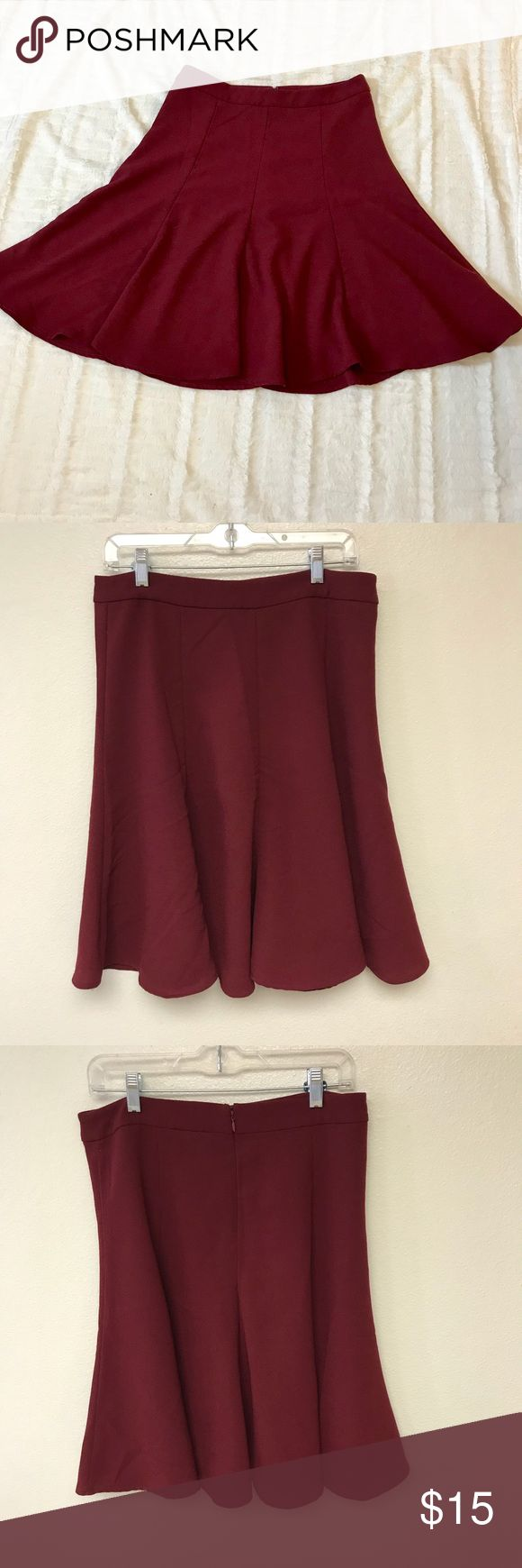 Old Navy Burgundy A line skirt size 10 Old Navy Burgundy A line skirt  - back zipper - no lined - 97% cotton 3% spandex   size 10   Length measures 25 in Waist laying flat measures approximately 16 in  Gently used no holes or stains Old Navy Skirts A-Line or Full