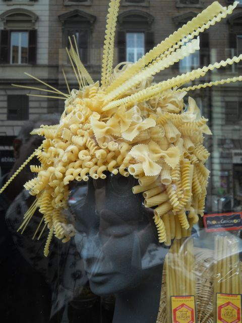 Window display in Rome.  This is a pasta shop but this concept would be great for a cafe or restaurant window ... dye the pasta in holiday colors and roll in Epsom salts for glitter in the Christmas season