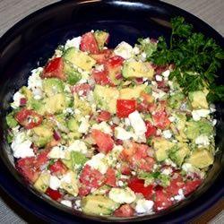 Avocado Feta Salsa - Chopped Tomatoes, Avocado, Red Onion, Oregano, Garlic, Feta, Olive Oil and Red or White Wine Vinegar.  Mix and Chill :)