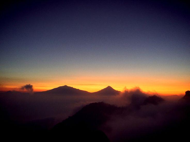 Sunrise from (left) Merbabu Mountain - Merapi Mountain, Puncak Suroloyo, Yogyakarta , Indonesia. 1100mdpl