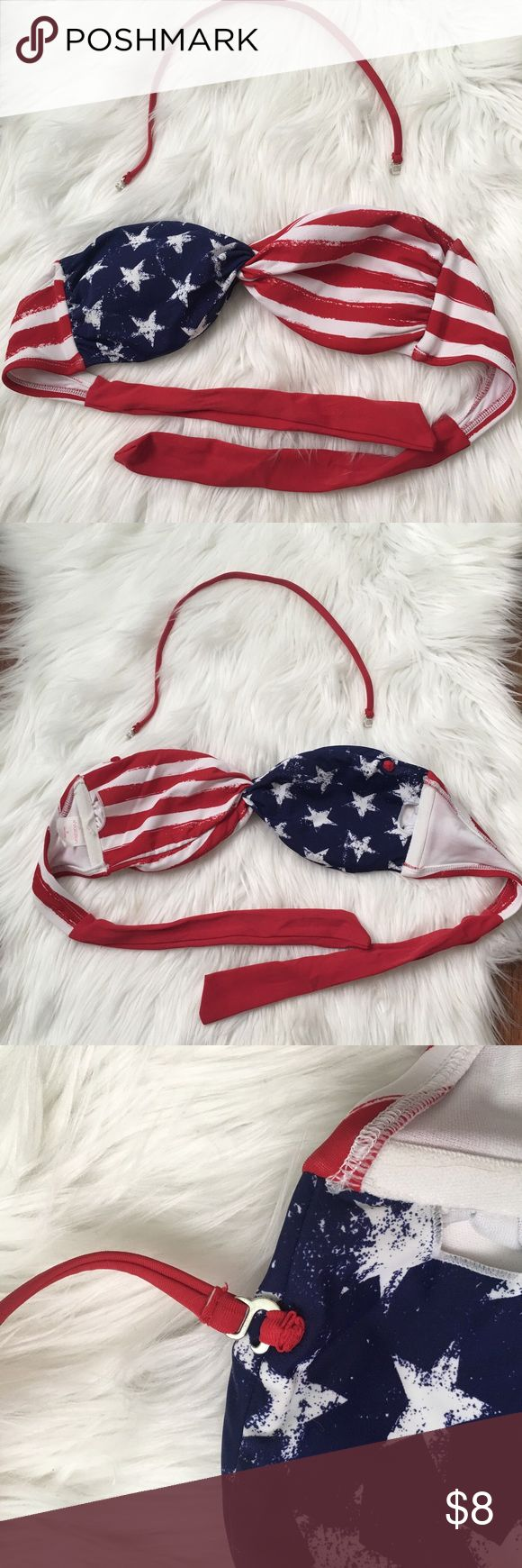 Patriotic bikini top size M This American flag bikini top has never been worn or washed! Like new. Got last year for 4th of July but never wore it. Just been sitting in my dresser since, needs a great new home. Has attachable halter strap and removable padding. Ties in the back so you can adjust tightness to your personal liking/size. 😊❤️🇺🇸 Xhilaration Swim Bikinis