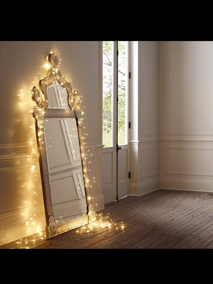 Even if you don't have a fancy mirror or cover your mirror (fancy or otherwise) in lights, putting mirrors opposite the windows can make a small room feel more open.