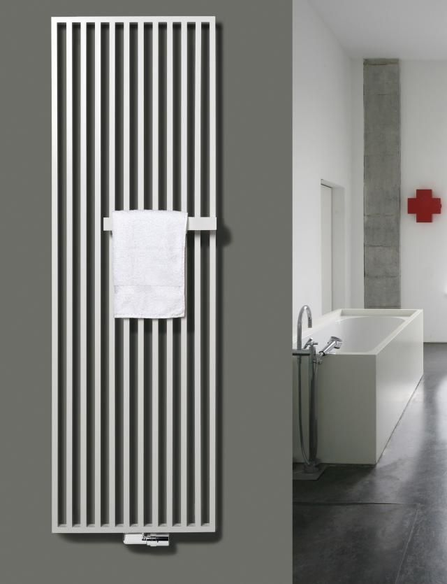 http://www.remodelista.com/posts/appliances-wall-radiator-roundup  Flat panel, wall mounted radiators. Game changer!