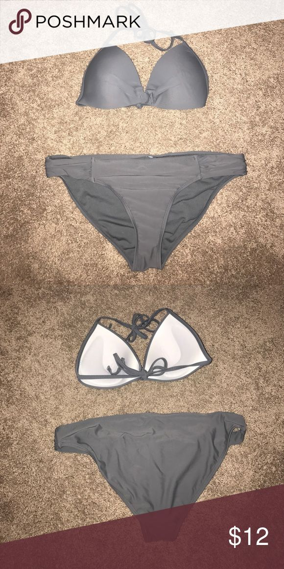 Grey bikini Grey blinking. They tags are cut out but the top is a medium and the bottoms are a large! Swim Bikinis