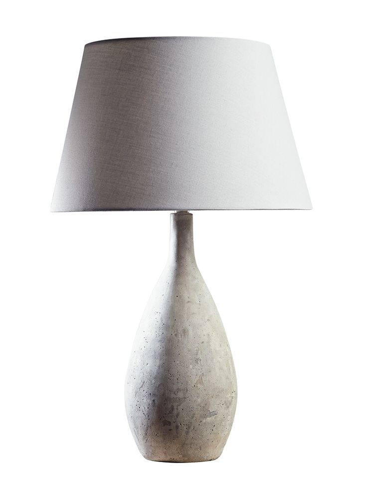 Carefully cast from smooth concrete in an elegant droplet shape, this weight based table lamp is topped with a simple soft grey cotton shade. This table lamp will add a cool, contemporary finish to your bedside or side table and will suit most existing interior styles. Click here to view our useful lighting buying guide, andtake a look at our blogfor ideas on how incorporate lighting into your home.