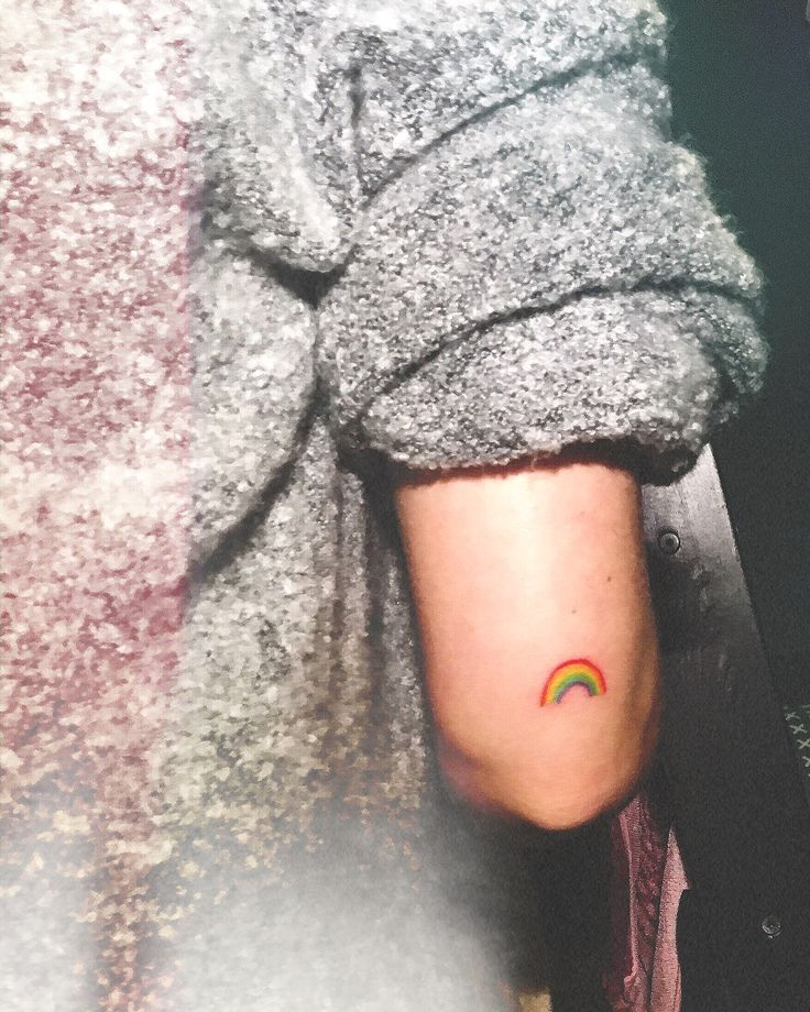 Minimalistic rainbow tattoo