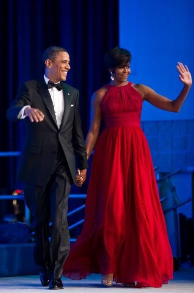 Hi, haters! First lady Michelle Obama, with President Barack Obama, waves as they arrive at the Congressional Black Caucus Foundation Phoenix Awards dinner in Washington, D.C., Sept. 18, 2010.
