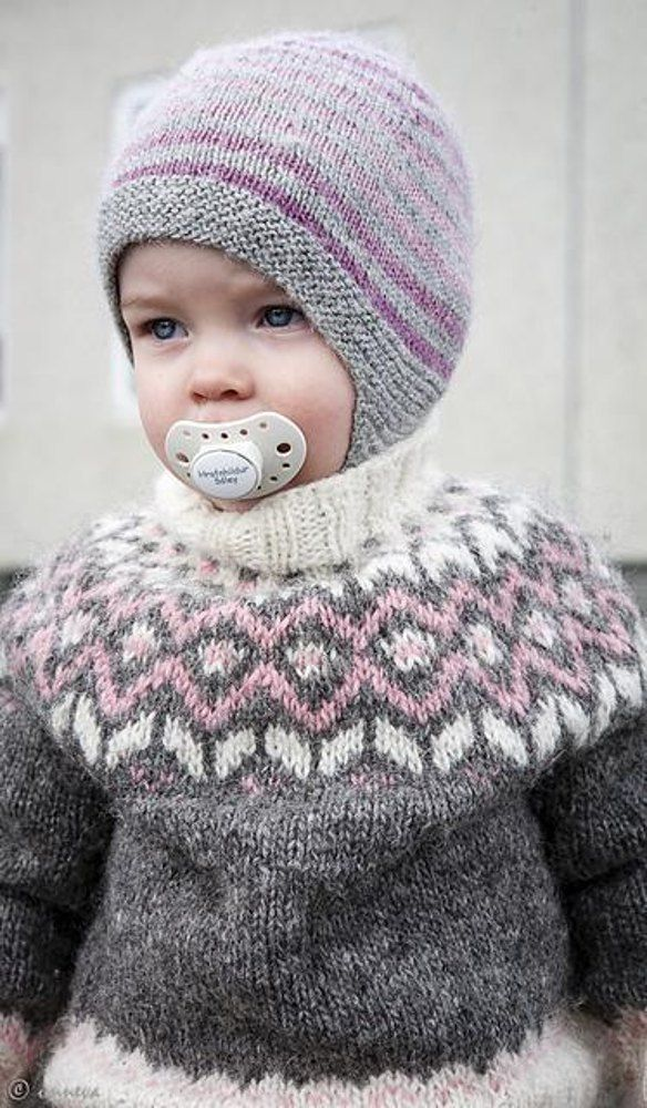 A cute little lopi-sweater for toddlers and kids. A traditional Icelandic yoke and high neck to keep warm during cold winter months! Find this pattern at LoveKnitting.Com.