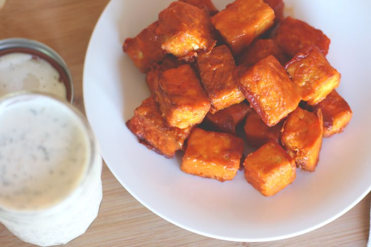 Crunchy on the outside, tender on the inside - these buffalo tofu bites are a vegetarian dream. Dipped in homemade vegan ranch, they're going to replace your favorite happy hour appetizer!