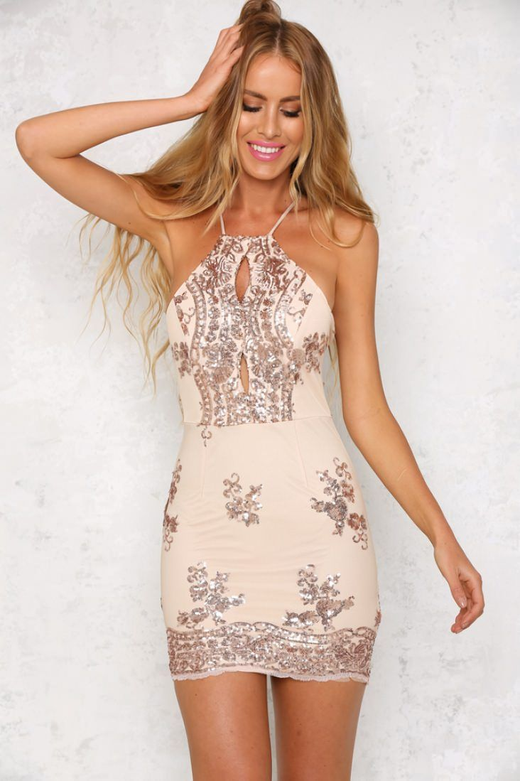 This stunning bodycon dress is sleeveless, with thin spaghetti straps, a crossover back, an invisible back zip at the waist and scalloped detailing at the lower back. We love the sheer rose gold sequin detailing over inner lining and the front cutouts! Wear with nude heels and a simple clutch!   Dress. Not lined. Cold hand wash only. Model is standard XS and is wearing XS. True to size. Print may vary in placement.  Non-stretchy fabric. Polyester/spandex.