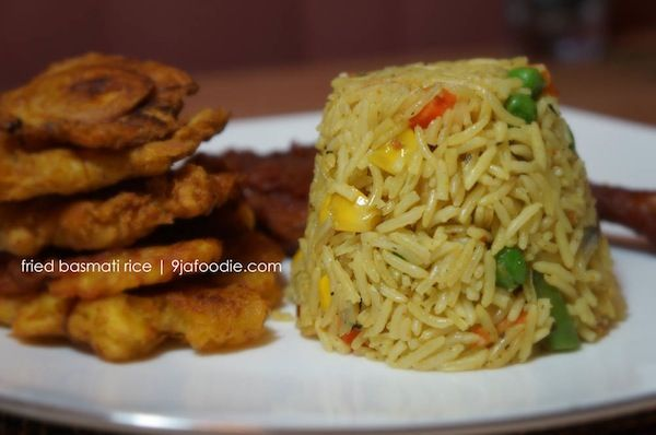 Fried Basmati Rice 4 tablespoons olive or vegetable oil (divided)  2 cubes maggi  2 teaspoon curry powder (divided)  1 teaspoon thyme powder (divided)  2 cups mixed vegetables  ¼ cups chopped spring onion (optional)  1.5 cups precooked shrimps or chicken (optional)  ½ teaspoons crushed red pepper  1teaspoon salt  3 cups basmati rice