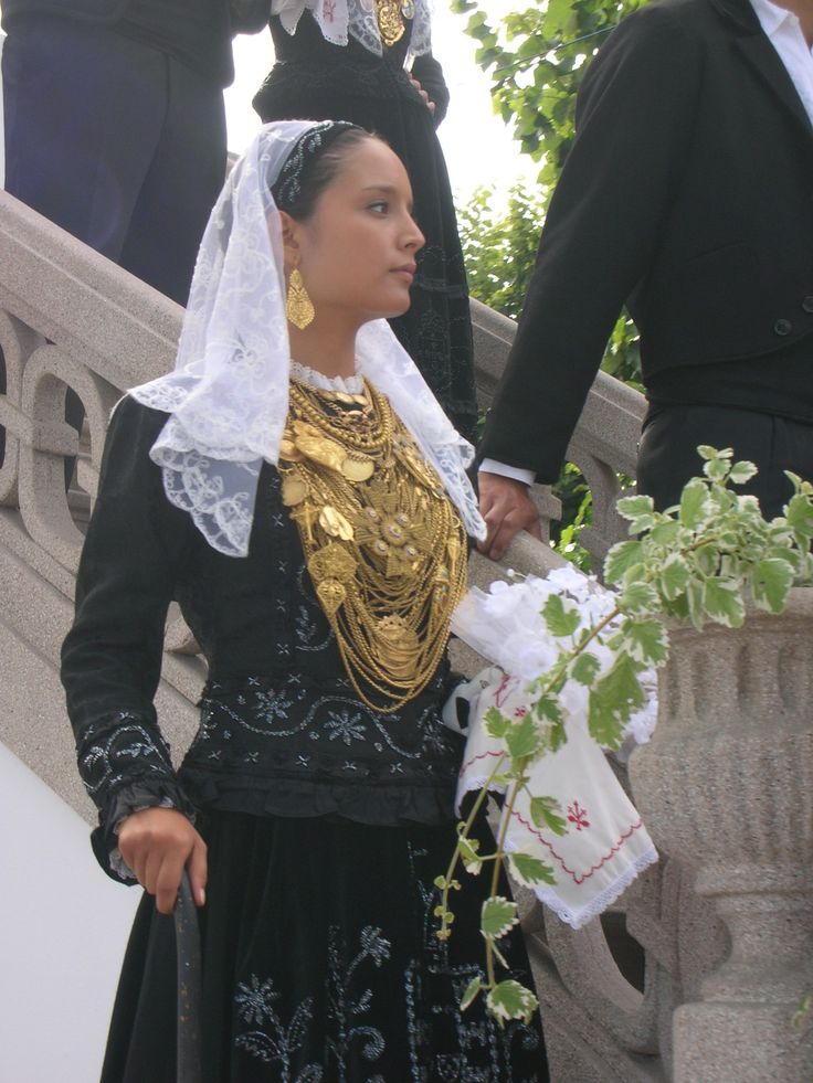 Beautiful traditional Portuguese outfit with gold jewelry. Viana do Castelo. Portugal.