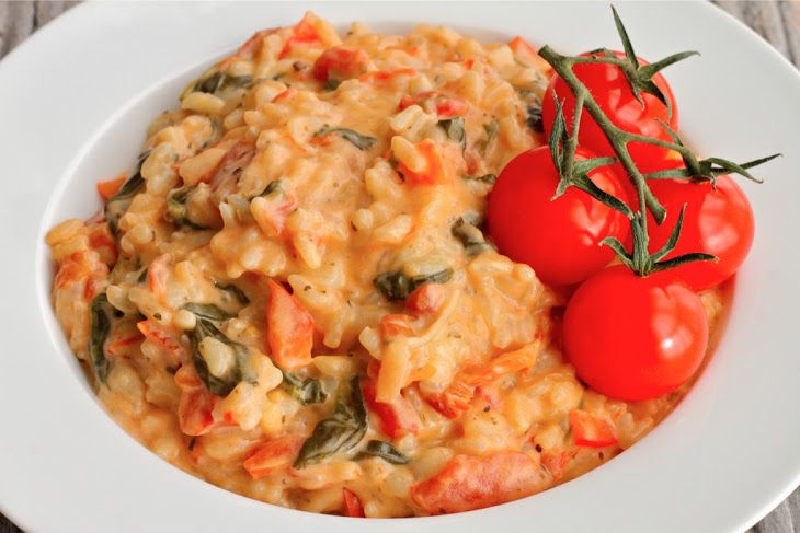 Creamy Goat Cheese Risotto Recipe Main Dishes with shallots, red pepper, mushrooms, garlic cloves, baby spinach, sun-dried tomatoes, white wine, chicken broth, risotto, diced tomatoes, goat cheese, grated parmesan cheese, butter