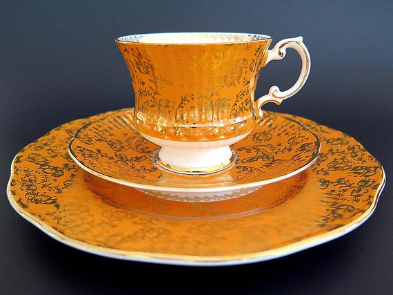 Vintage Elizabethan Orange Tea Cup Saucer Salad Plate Trio Pattern 5222.  Gorgeous Elizabethan Orange teacup trio featuring orange background, ornate gold hand painted design of scrolls, leaves and flowers, gold rims, gold decoration on cups foot and handle, gold design on the inside of