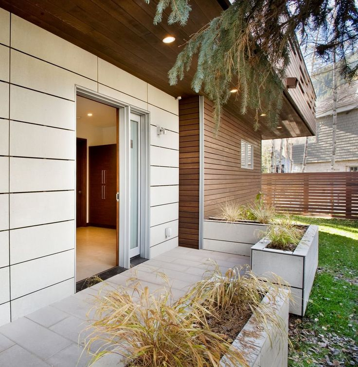 Front View Of Small Contemporary House In Swiss Style Design With White  House Wall Combined Wooden Wall And White Sliding Doors Awesome Design For  Small ...