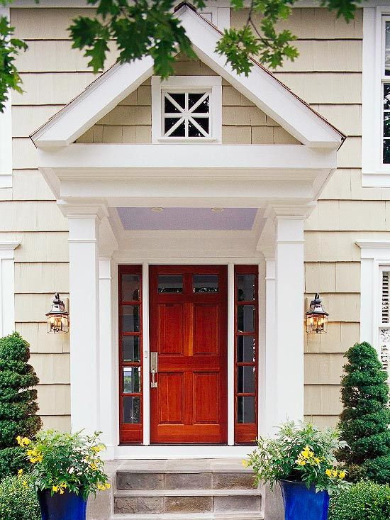 A classic wood door lets the pop of purple stand out. Find 10 ways to enhance your entry: http://www.bhg.com/home-improvement/exteriors/curb-appeal/enhance-front-entry/?socsrc=bhgpin071212classicfrontdoor#page=5