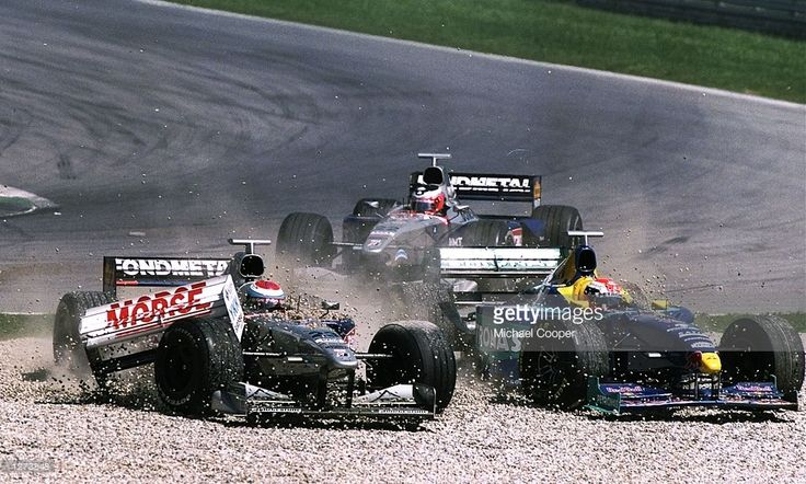 Minardi driver Esteban Tuero of Argentina and Sauber-Petronas driver Johnny Herbert of Great Britain hit the gravel early on in the Austrian Grand Prix at the A1 Ring in Spielberg, Austria. Tuero retired from the race and Herbert went on tofinish in eighth place. \ Mandatory Credit: Mike Cooper/Allsport
