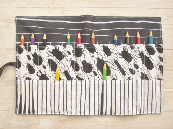 Roll up pencils case for color pencils, crochet hooks, paintbrushes etc. Case is made of black and white fabrics with spiders web, bugs and stripes. Size about: Height 21,5 cm / 8,5; width 32,5 cm / 13; width of the hollows 2,5 cm / 1. Case includes 12 high hollows (14 cm / 5,5) and 12 low hollows (7 cm / 3). Two ribbons to tie and close. For care: Machine wash cold with detergent for colorful laundry, no bleach, ironing hot. Note: Pencils on the photo are not included. See also in oth...