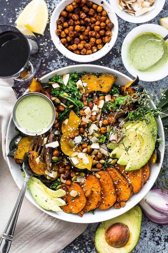 Sweet Potato, Squash and Kale Buddha Bowl with cilantro-tahini dressing and crispy chili-lime chickpeas