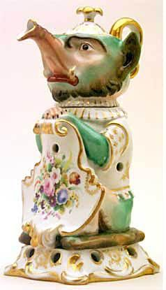 """Teapot #441  Figurine, """"Mythological Character"""", like a pig, long snout, white and gold rococo base, floral   shield with flowers on white, green arms, head and bottom green.  Acquired in Nice"""