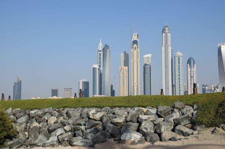 Dubai Marina looms over the man made embankments of the palm Jumeira