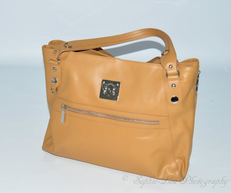 Our Cydney Changing #Bag with zip compartment.