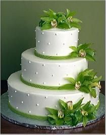 photos of three tier wedding cakes | Three tier white wedding cake with cascading green orchids.