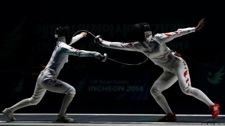 ISSEI KATO South Korea's Shin Alam (left) competes against China's Xu Anqi during their women's epee team fencing competition
