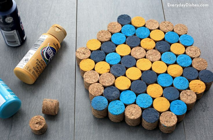 Set your hot pots and pans down on your homemade cork trivet. Paint the tops of the corks whatever color you'd like for a personalized touch.  Get the tutorial at Everyday Dishes & DIY.   - CountryLiving.com