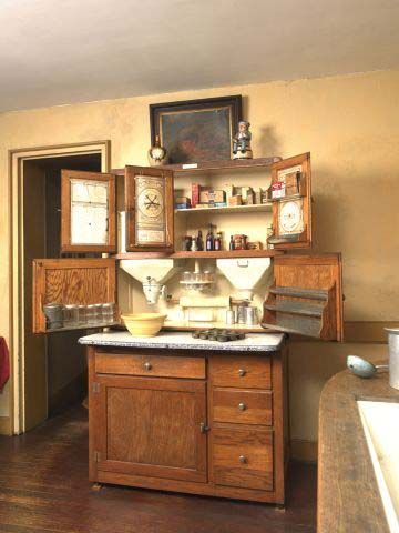 Hoosier cabinet - an arguably more useful single piece of furniture than a while bank of modern kitchen cabinets.